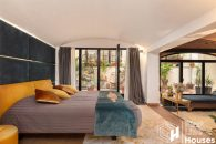 bright master bedroom with patio